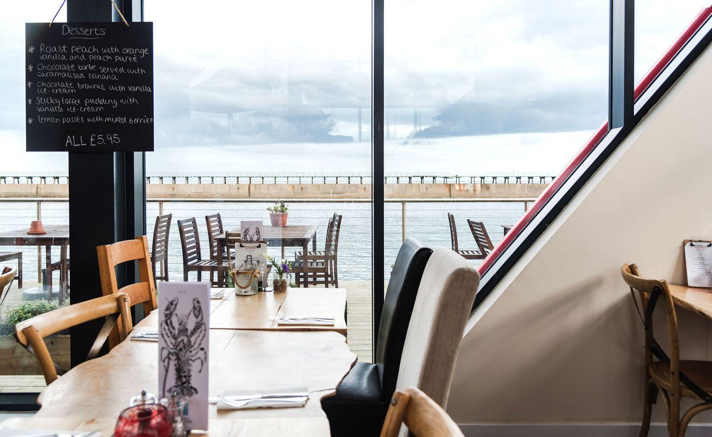 Blyth Boathouse restaurant interior with coastal views