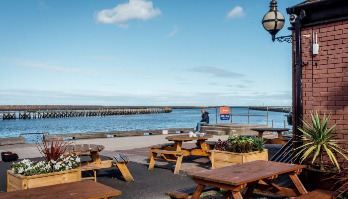 The Old Boat House Amble restaurant exterior and coastal views