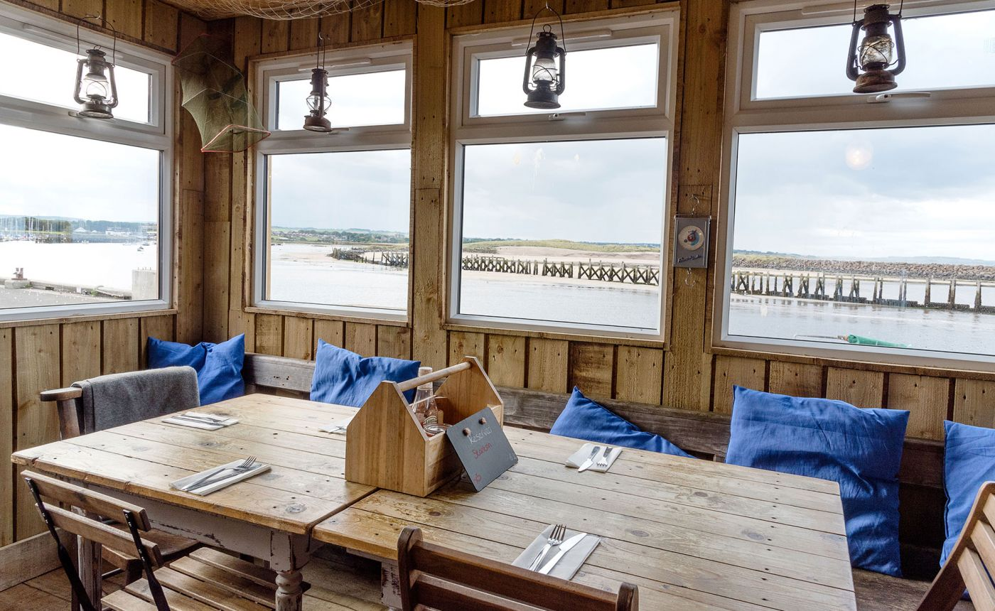 Fish Shack Amble restaurant interior with coastal view